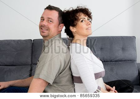 Couple Who Have Fallen Out Over A Disagreement Sitting On A Sofa