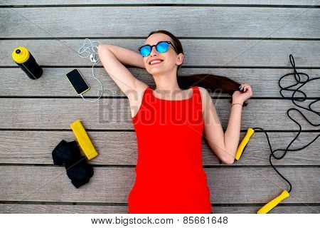 Sport woman on the sunbed