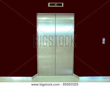 Elevator Door Maroon Wall