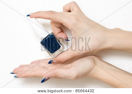 Nail Varnish Bottle Held Between Fingers