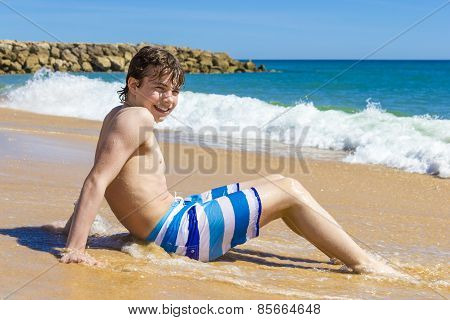 Boy Is Playing  In A Beautiful Sea