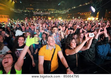MOSCOW - APR 05, 2014: A crowd of happy young people at the Trancemission in Stadium Live