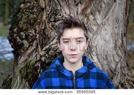 Portrait Of A Teenage Boy With Blue Plaid Lumberjack Jacket