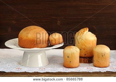 Kulichi, Traditional Russian Easter Cakes On White Pedestal On White Cloth