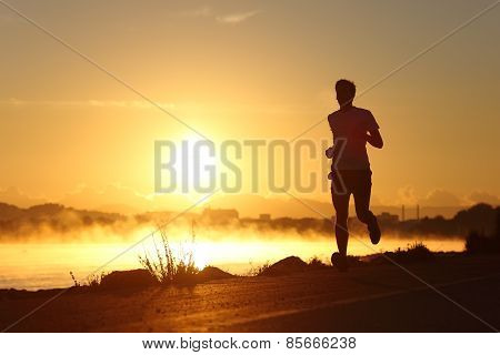 Silhouette Of A Man Running At Sunrise
