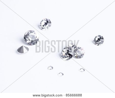 Jewellery. Few crystals on a white background