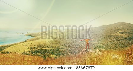 Traveler Standing On Peak Of Mountain