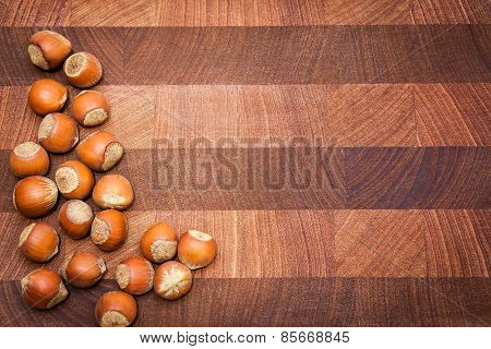 Wooden  background with hazelnuts and copy space