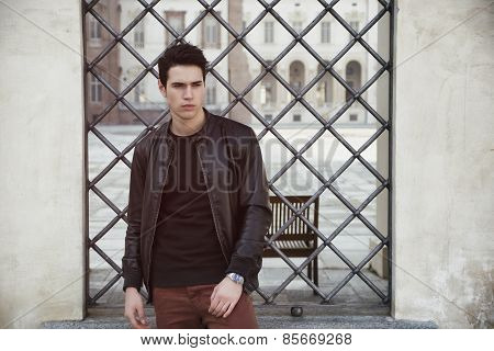 Handsome Young Man Outside Historical Building In European City