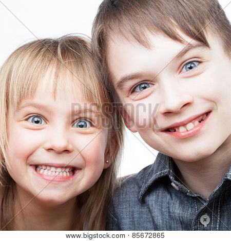 Portrait of happy sister and brother smiling