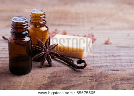 Bottles With Aroma Oil, Vanilla Pods And Hand Made Soap