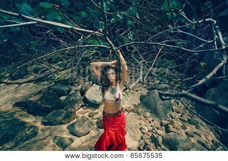 Tribal style girl on the stone rocks