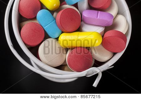 Pills In Bucket Close-up