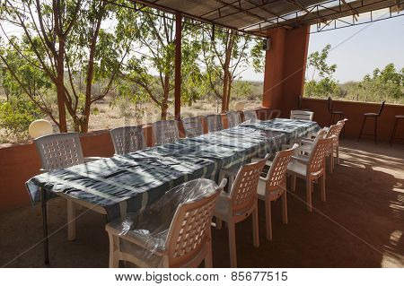 Long Table And Chairs On Veranda. Turmi. Ethiopia. Africa.