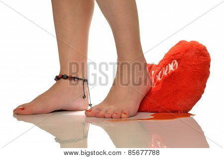Female feet, trampling loving heart