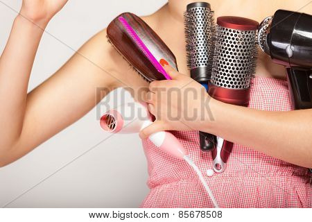 Girl Holds Many Accessories For Hair Styling