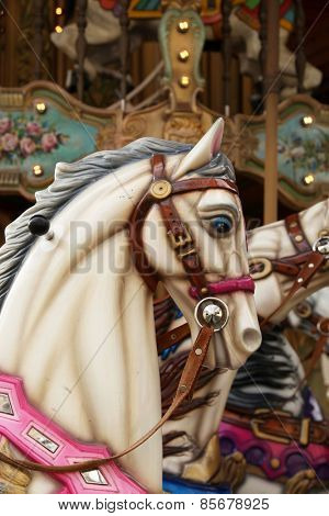 White horse in a carousel at the fair