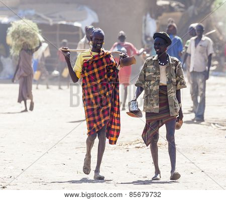 People In Traditional Village Of Dassanech Tribe. Omorato, Ethiopia