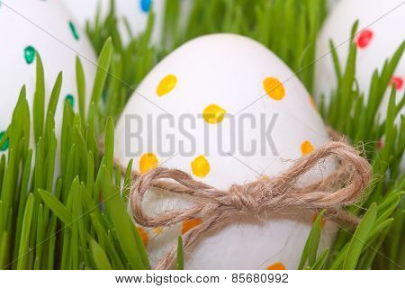 four easter eggs in spring grass