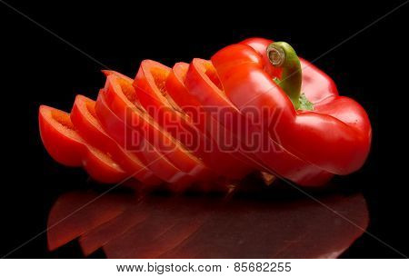 Closeup Slices Of Red Bell Peppers Isolated On Black