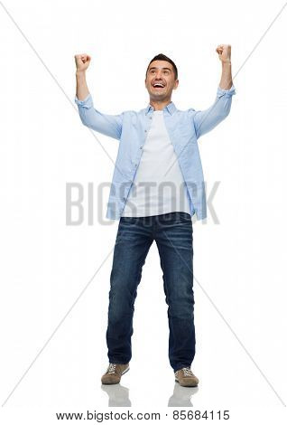 happiness, gesture and people concept - happy laughing man with raised hands