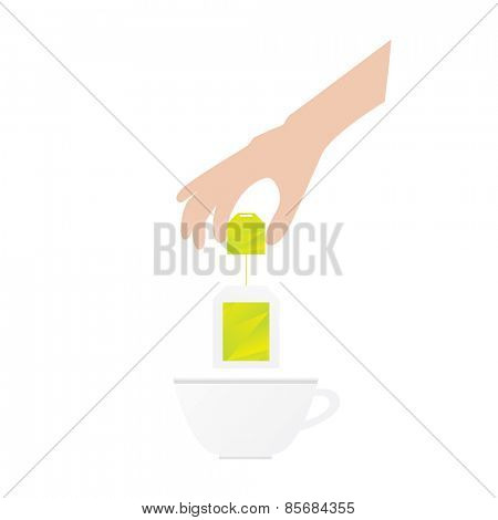 Humans hand is holding tea bag