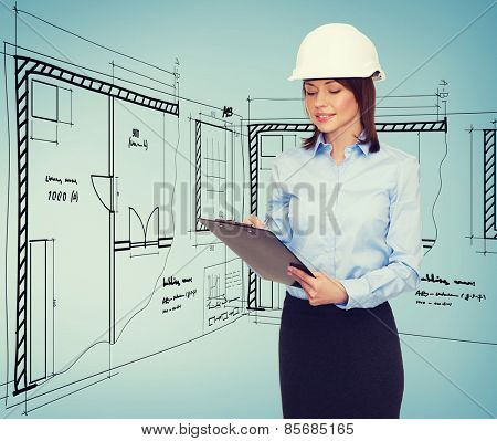 building, developing, consrtuction and architecture concept - smiling businesswoman in white helmet with clipboard