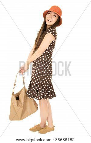 Beautiful Smiling Asian American Teen Girl Standing Holding Purse Wearing Polka Dot Dress