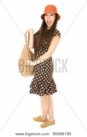 Teen Girl With A Happy Facial Expression Holding Her Purse