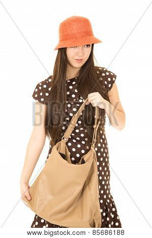 Cute Mixed Race Teen Girl Holding Her Purse Wearing An Orange Hat
