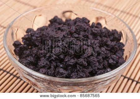 Dried blueberries in a glass bowl