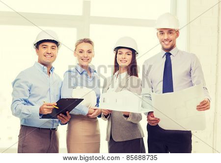 business, architecture and office concept - happy team of architects in office