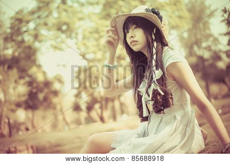 A Cute Asian Thai Girl Is Looking In The Sky With Hope In Natural Atmosphere In Vintage Color