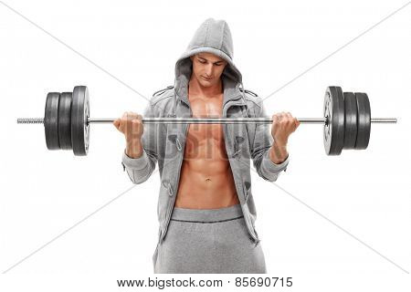 Young male bodybuilder exercising with a heavy barbell isolated on white background