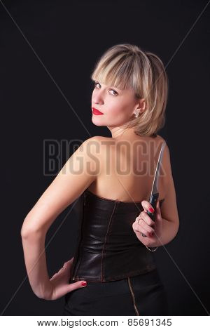 Model With Large Knife Behind Her Back