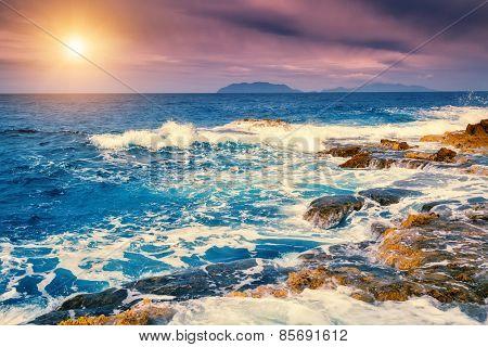 Fantastic view of the cape Milazzo (Piscina di Venere) and Lipari island. Dramatic scene. Overcast sky. Tyrrhenian sea. Sicilia, Italy, Europe. Beauty world. Retro style filter. Instagram effect.