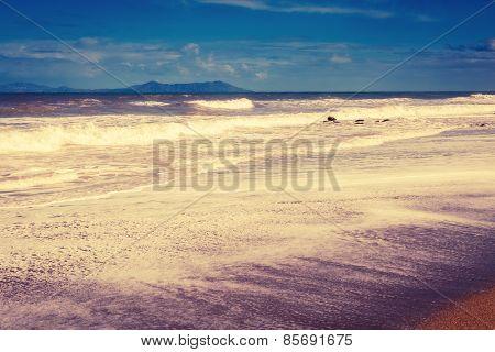 Fantastic view of Brolo beach and Lipari island (reserve Isola di Vulcano). Dramatic scene. Overcast sky. Tyrrhenian sea. Sicilia, Italy, Europe. Beauty world. Retro style filter. Instagram effect.
