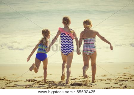 Summer Vacation fun at the Beach for three little girls