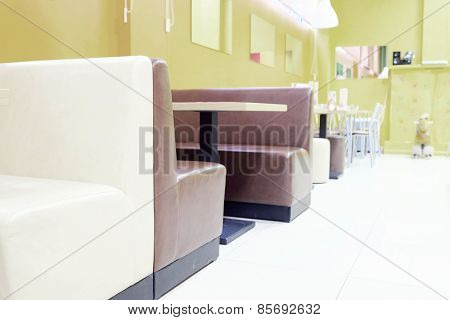 Modern restaurant interior with leather sofas