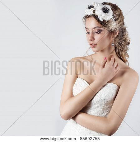 Happy beautiful bride woman blonde girl in a white wedding dress, with hair and bright make-up