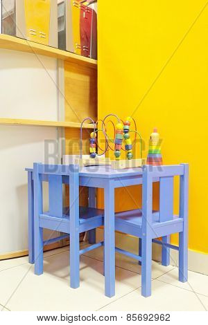 Small blue table and two chairs for little kids