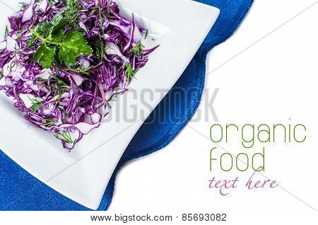 Portion of Red and parsley Coleslaw on white background. isolated.