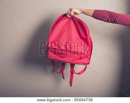 Female Hand Holding A Rucksack