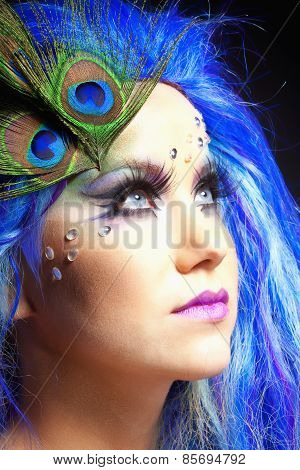 Woman In Blue Wig And Peacock Feathers