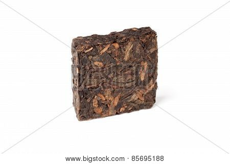 Square Briquette Of Black Chinese Shu Pu-erh Tea Isolated