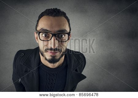 funny man with Nerd glasses smiling - wide angle shot