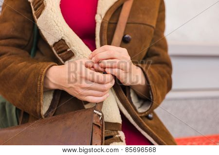 Woman Picking Her Nails