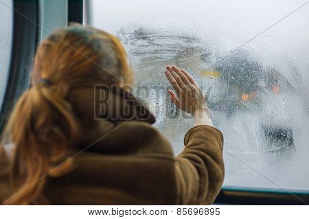 Woman Wiping Dew Off Window