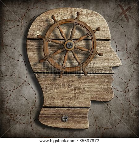 Old steering wheel over wood head silhouette as behavior control conception