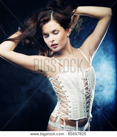 Fashion shoot of young sexy striptease dancer